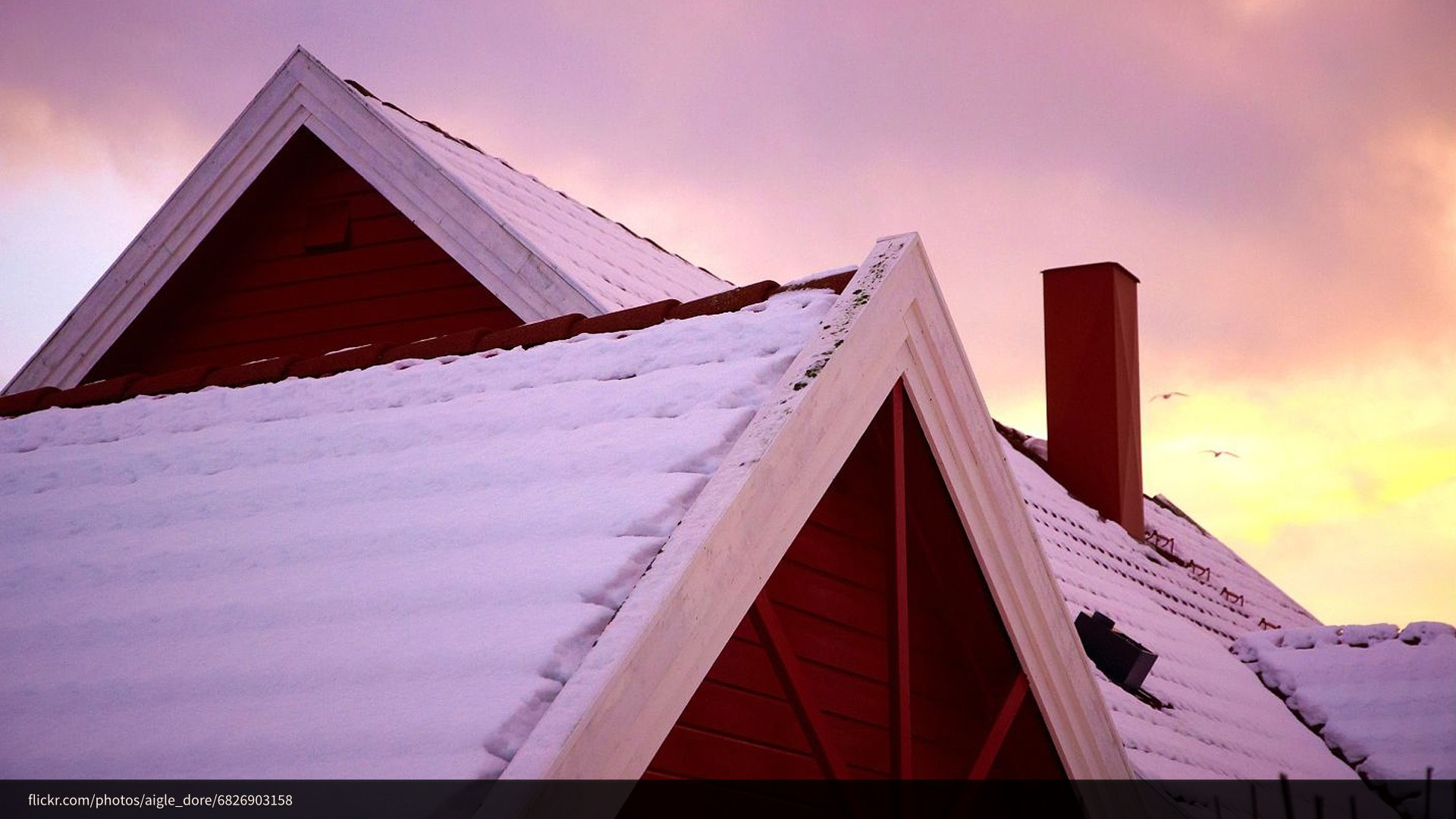 A photograph of a snow-covered roof